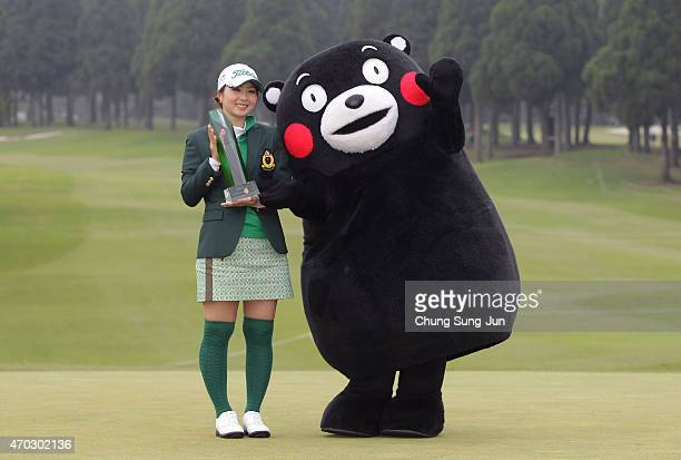 Erika Kikuchi of Japan lifts the trophy with Kumamoto prefecture's mascot Kumamon during a ceremony following the KKT Cup Vantelin Ladies Open at the...