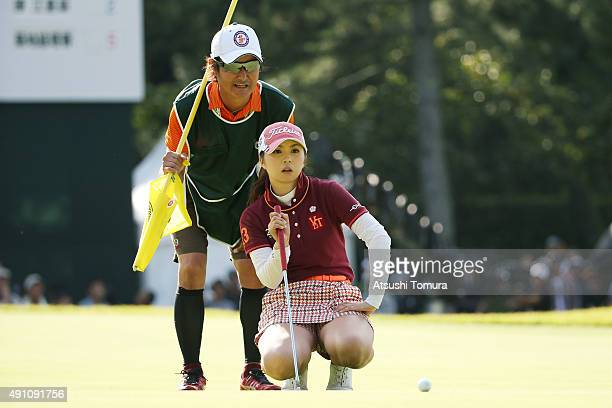 Erika Kikuchi of Japan lines up her par putt on the 18th green during the third round of Japan Women's Open 2015 at the Katayamazu Golf Culb on...