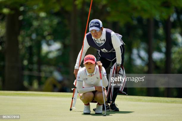 Erika Kikuchi of Japan prepares to putt on the 15th green during the final round of the CyberAgent Ladies Golf Tournament at Grand fields Country...