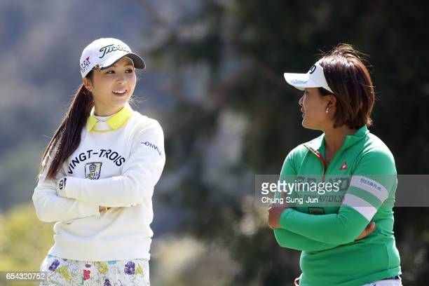 Erika Kikuchi of Japan talks with Ai Suzuki of Japan on the fifth hole in the first round during the T-Point Ladies Golf Tournament at the Wakagi...