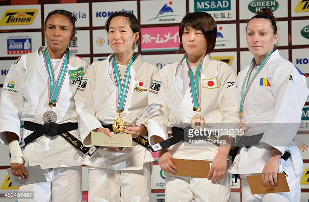 Erika Miranda of Brazil Yuki Hashimoto of Japan Ai Shishime of Japan and Jaana Sundberg of Finland stands on the podium at the women's 52kg medal...
