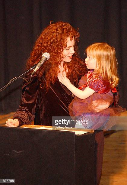 Erika Muller and daughter Dianna attend a benefit reading for her husband Frank Muller at Town Hall February 2 2002 in New York City Actor and...