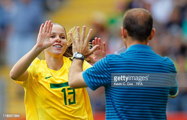 Erika of Brazil celebrates her goal against Equatorial Guinea with head coach Kleiton Lima during the FIFA Women's World Cup 2011 Group D match...