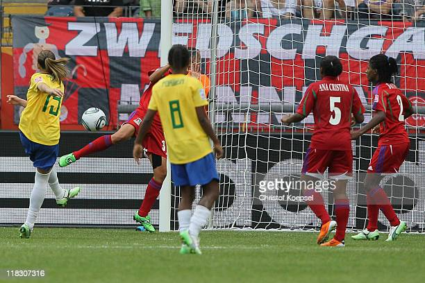 Erika of Brazil scorews the first goal during the FIFA Women's World Cup 2011 Group D match between Equatorial Guinea and Brazil at FIFA World Cup...