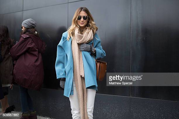Erika Pinto is seen at Lacoste wearing Dior glasses vintage Ferragamo coat Forever 21 scarf and Lacoste pants and shoes during New York Fashion Week...
