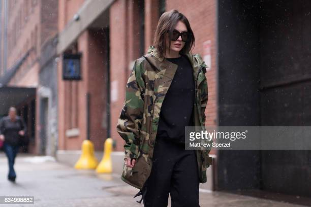 Erika Riches is seen attending Public School during New York Fashion Week wearing a camo jacket and all black outfit on February 12 2017 in New York...