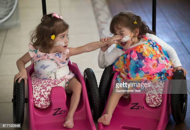 Erika Sandoval left lashes out at her twin sister Eva Sandoval as their wheelchairs collide while cruising around the house Wednesday June 14 2017 in...