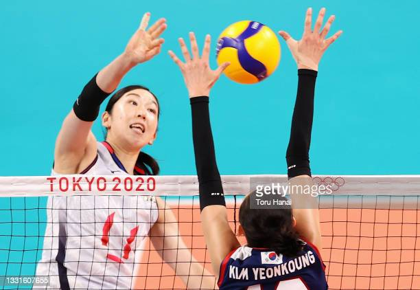 Erika Shinomiya of Team Japan competes against Yeon Koung Kim of Team South Korea during the Women's Preliminary - Pool A volleyball on day eight of...