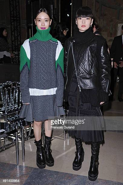 Erika Toda, Kozue Akimoto and guest attend the Sacai show as part of the Paris Fashion Week Womenswear Spring/Summer 2016 on October 5, 2015 in...