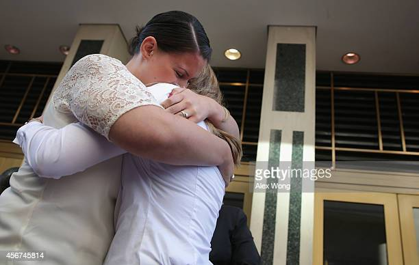Erika Turner and Jennifer Melsop of Centreville Virginia embrace each other after they became the first same sex marriage couple in Arlington County...