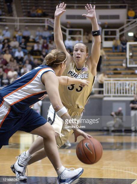 Erika Valek hounds Illinois' Maggie Acuna as she tries to bring the ball upcourt in the 2nd half of Purdue's 65-49 win.