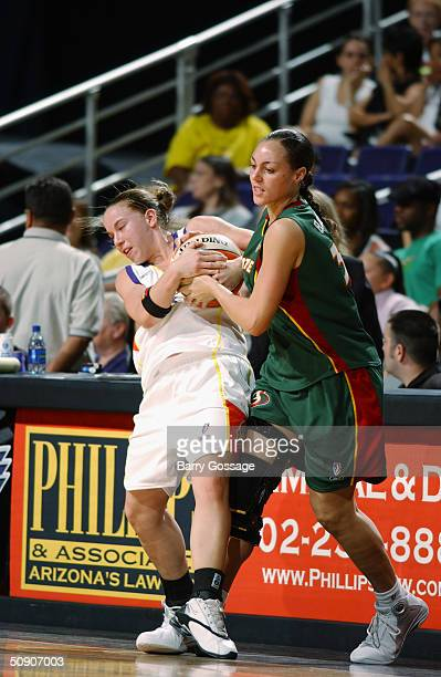 Erika Valek of the Phoenix Mercury is pressured by Adia Barnes of the Seattle Storm during the WNBA preseason game at America West Arena on May 5...