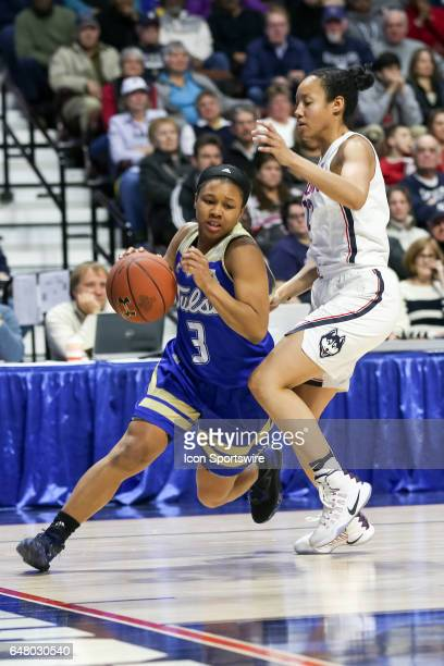 Erika Wakefield of Tulsa drives the baseline during the quarterfinal game of the AAC Women's Basketball Championship Tournament between the UConn...