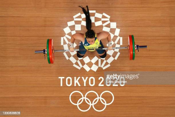 Erika Yuriko Iris Yamasaki of Team Australia competes during the Weightlifting - Women's 59kg Group B on day four of the Tokyo 2020 Olympic Games at...