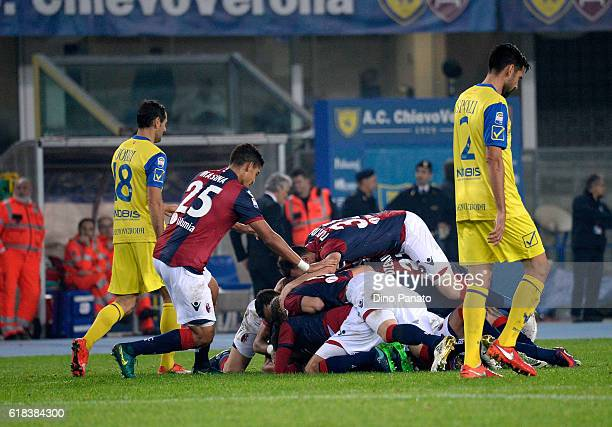 Erikck Pulgar of Bologna FC is mobbed by team mates aafter scoring his opening goal during the Serie A match between AC ChievoVerona and Bologna FC...