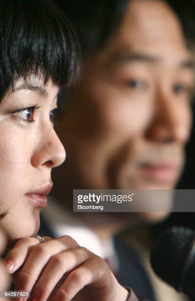 Eriko Fukuda a plaintiff infected with hepatitis C left attends a news conference with Ryuhei Kawada a member of the House of Councilors in Tokyo...