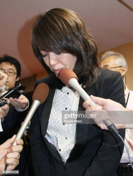 Eriko Imai a member of the House of Councillors from the ruling Liberal Democratic Party bows in apology while meeting the press at the party...