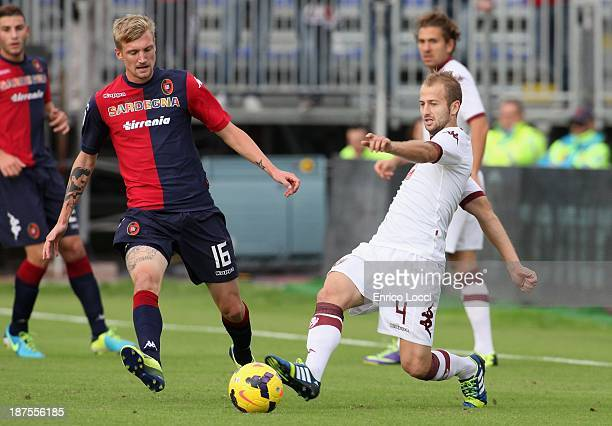 Eriksson Sebastian of Cagliari competes for the ball with Basha Migjen of Torino during the Serie A match between Cagliari Calcio and Torino FC at...