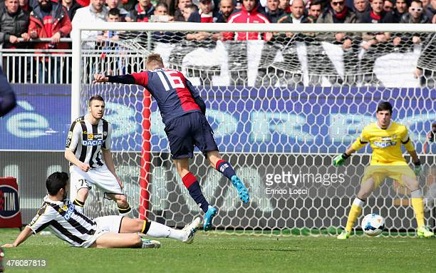 Eriksson Sebastian of Cagliari competes with Pinzi Giampiero of Udinese during the Serie A match between Cagliari Calcio and Udinese Calcio at Stadio...