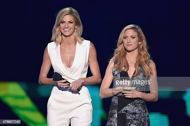 Erin Andrews and Brittany Snow perform onstage during the 2015 CMT Music awards at the Bridgestone Arena on June 10 2015 in Nashville Tennessee