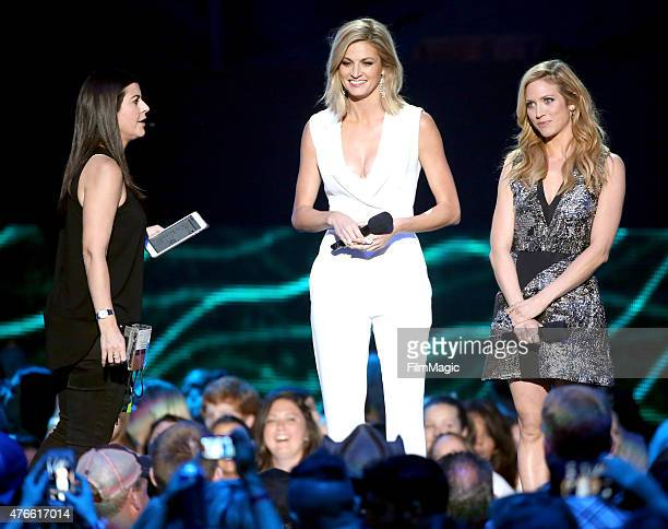 Erin Andrews and Brittany Snow speak onstage during the 2015 CMT Music awards at the Bridgestone Arena on June 10 2015 in Nashville Tennessee