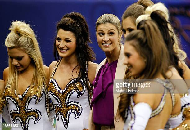 Erin Andrews poses with members of the Louisiana State University Tigers cheerleading squad priot to the 2012 Allstate BCS National Championship Game...