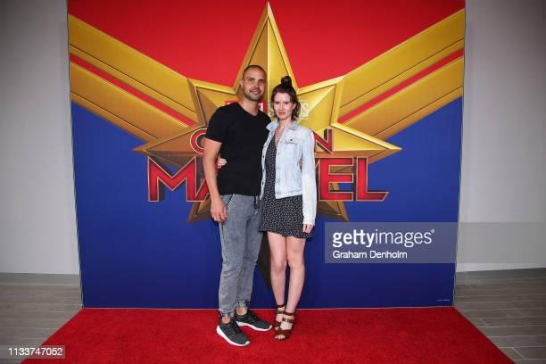 Erin Bateman and partner attend the Marvel Studios' Captain Marvel Premiere at Hoyts The District Docklands on March 05 2019 in Melbourne Australia
