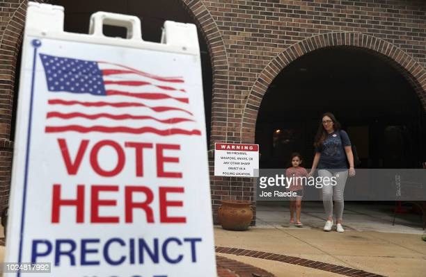 Erin Beazzo and her daughter Fionna Beazzo leave after she voted at a polling station on Florida primary election day on August 28 2018 in St...