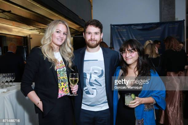 Erin Becker Greg James and Rachel Silverman during A Blade of Grass Annual Night of Alchemy on November 7 2017 in New York City