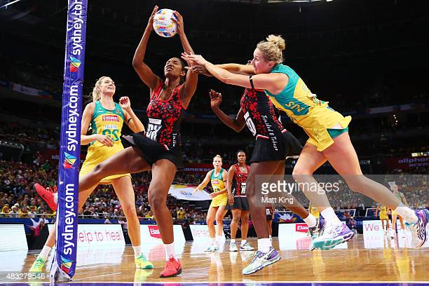 Erin Bell of the Diamonds competes with Daystar Swift of Trinidad Tobago during the 2015 Netball World Cup match between Australia and Trinidad...