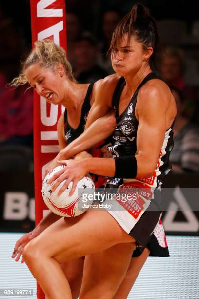 Erin Bell of the Thunderbirds clashes with Sharni Layton of the Magpies during the round 14 Super Netball match between the Thunderbirds and Magpies...