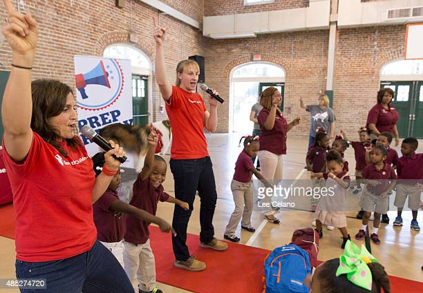 Erin Bradshaw Save the Children Sr Director for Emergency Preparedness leads children in dance at a special Katrinaanniversary Prep Rally at Kingsley...