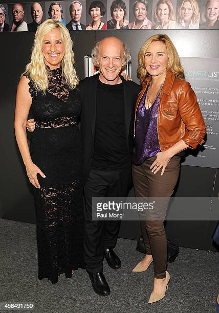 Erin Brockovich photographer Timothy GreenfieldSanders and Kim Cattrall pose for a photo at the opening of The Boomer List Photographs by Timothy...
