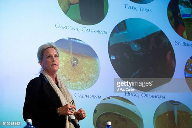 Erin Brockovich stands in front of a computer image showing photos of water samples from around the country as she speaks during an Oklahoma...