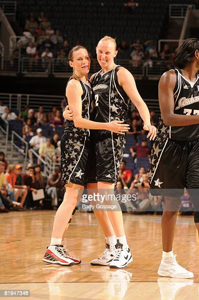 Erin Buescher and Ann Wauters of the San Antonio Silver Stars celebrate a victory over the Phoenix Mercury on July 15 at US Airways Center in Phoenix...