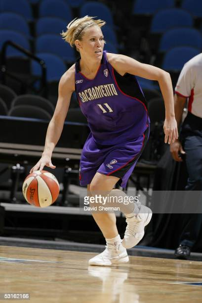 Erin Buescher of the Sacramento Monarchs dribbles against the Minnesota Lynx during the WNBA game on May 29 2005 at the Target Center in Minneapolis...