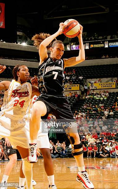 Erin Buescher of the San Antonio Silver Stars rebounds over Tamika Catchings of the Indiana Fever at Conseco Fieldhouse on June 15 2008 in...