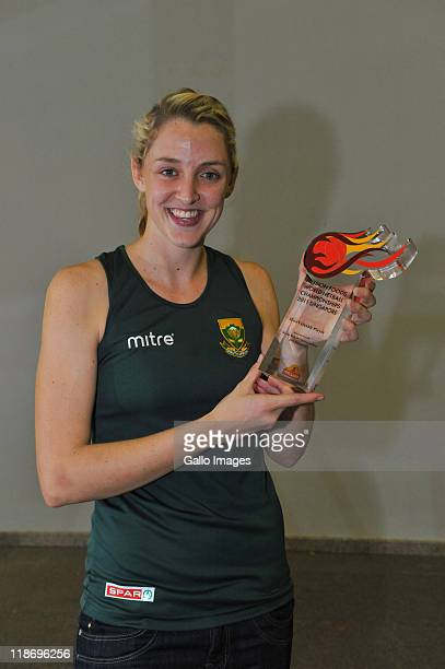 Erin Burger of South Africa is awarded the Player Of The Tournament trophy after their match against Malawi on day 8 of the Mission Foods World...