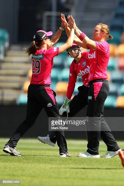Erin Burns and Sarah Aley of the Sixers celebrate taking the wicket of Lauren Winfield of the Hurricanes during the Women's Big Bash League match...