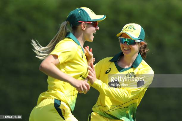 Erin Burns of Australia A Women celebrates with a teammate at Haslegrave Ground on June 29 2019 in Loughborough England