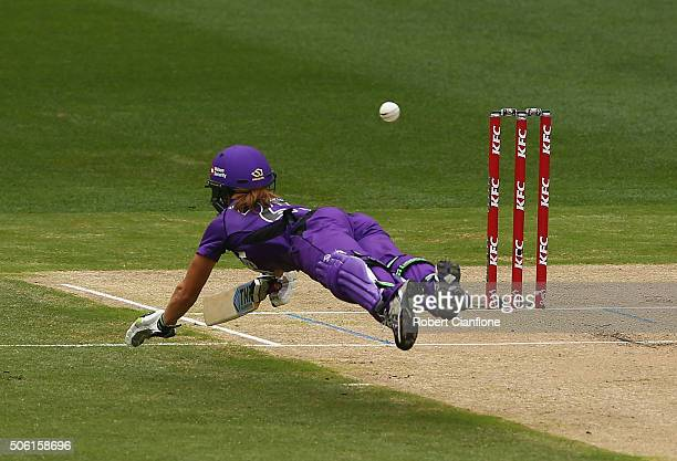 Erin Burns of the Hurricanes dives for her crease to avoid an attempted run out during the Women's Big Bash League Semi Final match between the...