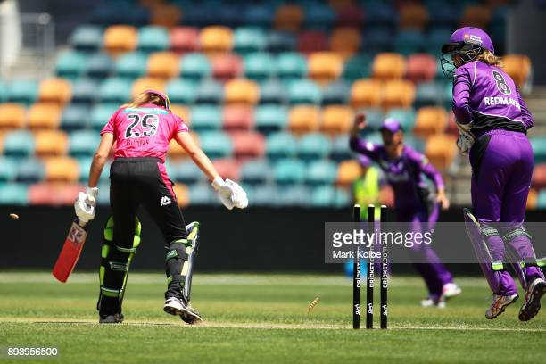 Erin Burns of the Sixers is stumped by Georgia Redmayne of the Hurricanes during the Women's Big Bash League match between the Hobart Hurricanes and...