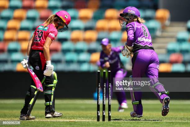 Erin Burns of the Sixers looks dejected as Georgia Redmayne of the Hurricanes appeals successfully for her stumping during the Women's Big Bash...