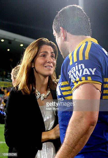 Erin Cayless congratulates husband Nathan Cayless of the Eels after playing his last match after the round 26 NRL match between the Parramatta Eels...