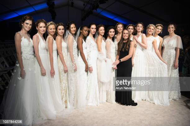 Erin Clare Bridal designer Erin Oberem poses for a photo backstage with models at Vancouver Fashion Week Spring/Summer 19 Day 4 on September 20 2018...
