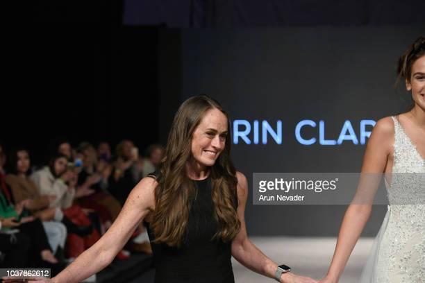Erin Clare Bridal designer Erin Oberem walks the runway with a model at Vancouver Fashion Week Spring/Summer 19 Day 4 on September 20 2018 in...