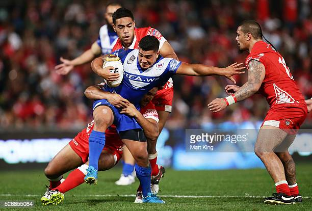 Erin Clark of Samoa is tackled during the International Rugby League Test match between Tonga and Samoa at Pirtek Stadium on May 7 2016 in Sydney...