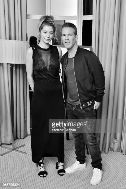 Erin Cullison and Scott Lipps attend Diesel Presents Scott Lipps Photography Exhibition 'Rocks Not Dead' at Sunset Tower on June 28 2018 in Los...