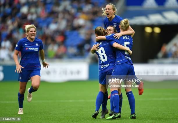 Erin Cuthbert of Chelsea celebrates with teammates after scoring her team's first goal during the Women UEFA Champions League semi final match...