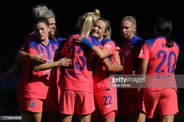 Erin Cuthbert of Chelsea celebrates with teammates after scoring her sides first goal during the Women's FA Cup Quarter Final match between Everton...